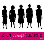 Set of women's silhouettes — Stock Vector