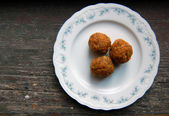 Carrot truffles with poppy seeds on plate — Stock Photo