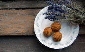 Carrot truffles with lavender on a plate — Photo