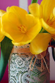 Yellow tulips in lace vase — Stock Photo