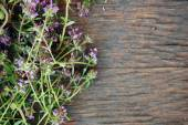 Background of fresh thyme on wooden table — Stock Photo