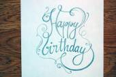 Vintage Happy Birthday calligraphic text — Stock Photo