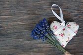 Lavender flowers and lavender bag on table — Stock Photo