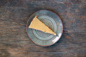 Slice of raw vegan carrot cake with cashew cream — Stock Photo