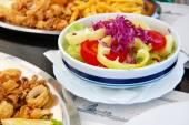 Deep fried seafood with fresh salad — Stock Photo