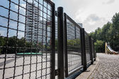 Looking through the chain-link fence on a high-rise estate — Stock Photo