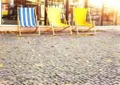 Deck chairs in the middle of the city — Stock Photo