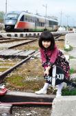 Little girl on a train station — Stock Photo