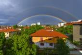 Double rainbow over the city — Stock Photo