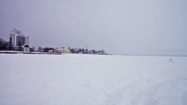 Frozen Onega lake quay covered with snow — Stock Video