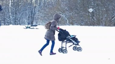 Woman Carries a Stroller with Baby — Stock Video