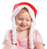 Little girl in a Christmas hat — Stock Photo
