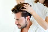 Masseur doing massage on man body in the spa salon. — Stock Photo