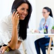 Young pretty business woman with mobile phone in her office. — Stock Photo #53297239