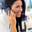 Young pretty business woman with mobile phone in her office. — Stock Photo #53297763