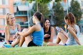 Running girls having fun in the park with mobile phone. — Stock Photo