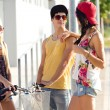 Group of friends with roller skates and bike riding in the park. — Stock Photo #53778527