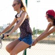 Group of friends with roller skates and bike riding in the park. — Stock Photo #53779461