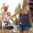 Group of friends with roller skates and bike riding in the park. — Stock Photo #53779837