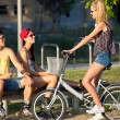 Group of friends with roller skates and bike riding in the park. — Stock Photo #53780759