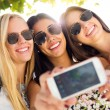 Three friends taking photos with a smartphone — Stock Photo #54302369