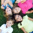 Group of childrens having fun in the park. — Stock Photo #54404607