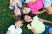 Group of childrens having fun in the park. — Stock Photo