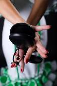 Hands detail of flamenco dancer in beautiful dress on black back — Stock Photo
