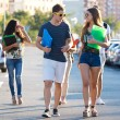 A group of friends talking in the street after class — Stock Photo #55520295