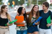 A group of friends talking in the street after class  — Stock fotografie