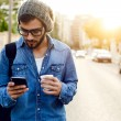 Modern young man with mobile phone in the street. — Stock Photo #57403861