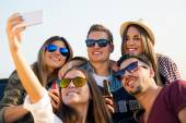 Group of friends taking a selfie with smartphone. — Stock Photo