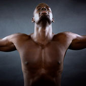 Muscular man with his arms outstretched. Freedom concept. — Stock Photo