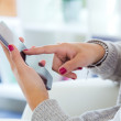 Female hands holding smartphone at home. — Stock Photo #59350883