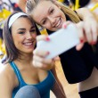 Young women taking a selfie in the gym. — Stock Photo #60948351
