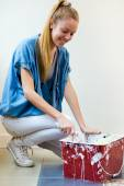 Young beautiful woman painting hew new home. — Stock Photo