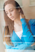 Depressed young woman sitting at home. — Stock Photo