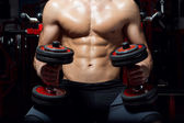 Young man doing heavy weight exercise in gym. — Stock Photo