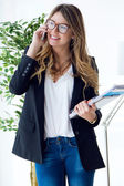 Business young woman using her mobile phone in the office. — Stock Photo