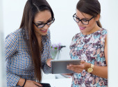 Young beautiful women working in the office. — Stock Photo