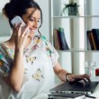 Pretty young woman using her mobile phone in the office. — ストック写真 #73317737