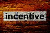 Incentive text on grunge background — Stock Photo