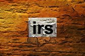 Irs text on grunge background — Stock Photo