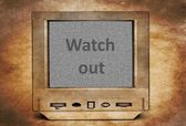 Watch out sign on vintage TV — Stock Photo