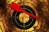 Dart on grunge publish target concept — Stock Photo