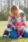 Mother her baby and puppy — Stock Photo