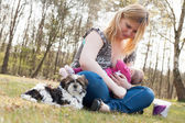 Sweet puppy while mother is feeding her daughter — Stock Photo