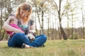 Mother with puppy and baby on the grass — Stock Photo