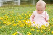 Baby and buttercups — Stock Photo