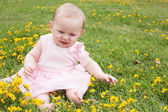 Baby's fun with buttercups — Stock Photo